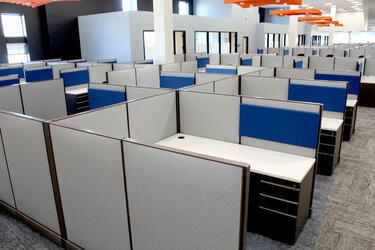 Several cubicle workspaces in Grand River Aseptic Manufacturing.