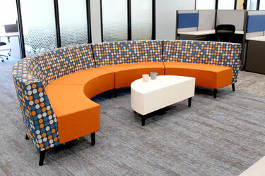 A colorful seating area in Grand River Aseptic Manufacturing.