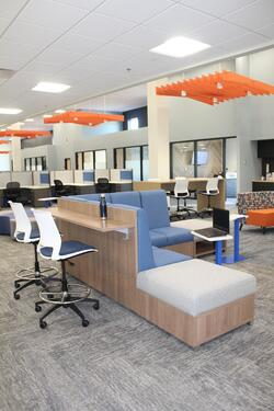 Single seat and collaborative workspaces inside of Grand River Aseptic Manufacturing.